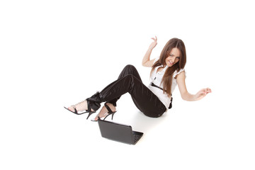 casual woman with a laptop, working on the floor.