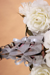 Wedding favors and white rose bouquet