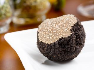 Fototapeta Mushroom of truffle on a white dish obraz