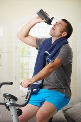 Man drinking water during exercise