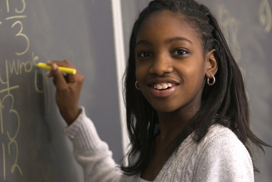 Student doing math on chalk board
