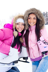 two girls go ice skating