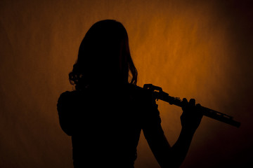 Flute Player girl Teenage Silhouette on Yellow