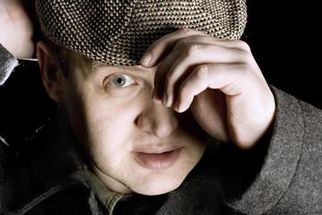 man wearing flat cap