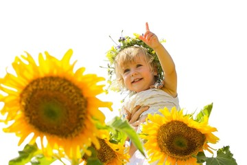 Beautiful little girl and sunflowers