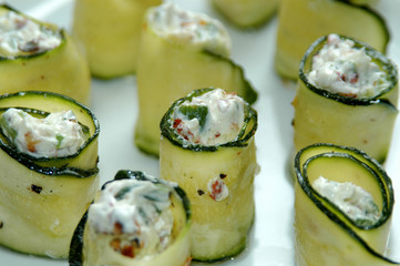 zucchini roll with cottage cheese and herbs