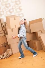 Moving house: Woman holding big carton box
