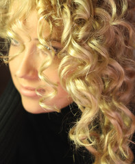 Foto op Canvas Vlam beautiful girl with long blonde curly hair healthy