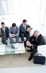 International Business people sitting and waiting for a job inte