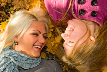 portrait of young smiling women on the ground