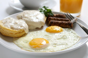 Foto op Plexiglas Gebakken Eieren Fried Eggs and Biscuits and Gravy