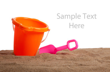 An bucket and shovel on the beach with copy space