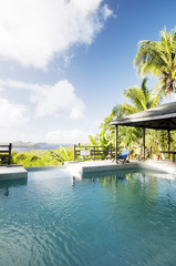 caribbean island villa pool with lovely view of grenadine island