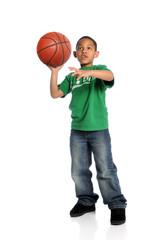 Young Boy Playing Basketball