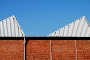 Old brick stone factory building with modern cladding
