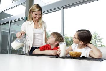 Mother serving breakfast