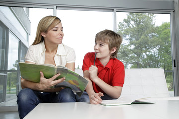 Mother helping with boy's homework