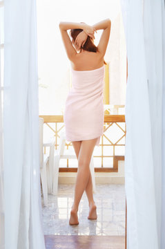 Pretty woman with long legs after shower