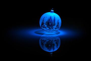 Blue Snowflake bauble on black background.
