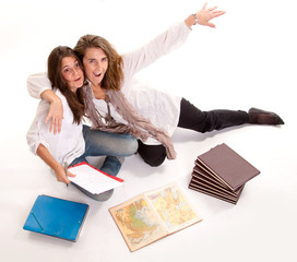 Mother joking with her daughter at homework