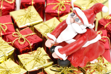 Santa Claus sitting on Christmas gifts concept