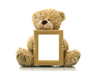 Cute bear holding empty frame for picture or photo