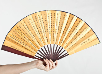 Wood chinese fan on white background