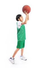 Kid playing with basketball