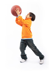 Small child playing with basketball