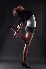 RnB woman dancer against black background