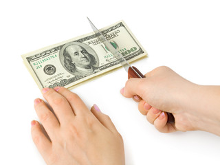 Hands with knife cutting money