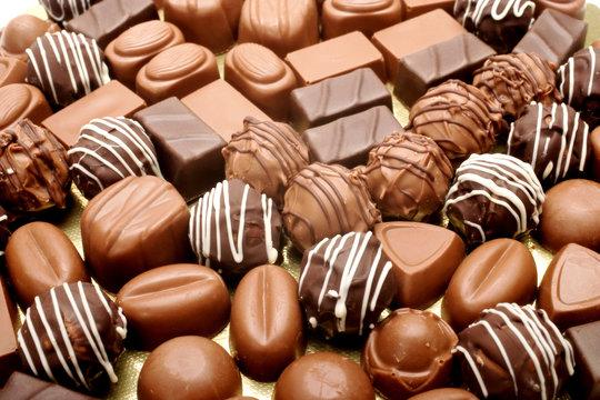 close up shot of chocolates on white background