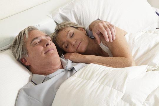 Seniors couple sleeping