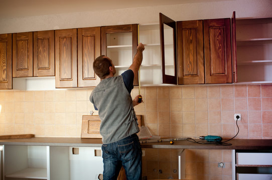 Carpenter working on new kitchen cabinets
