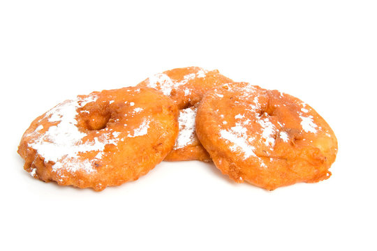 three home bakes apple fritter over white background