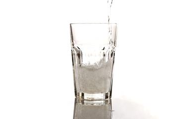 glass of mineral water isolated on white background