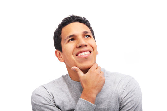 Young adult man looking up smiling