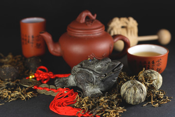 Chinese a toad of happiness and a set for tea ceremony