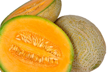 Fresh ripe melons and slices of it, showing pulp and seeds.