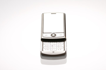 A cellphone on a glass table