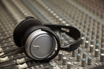 headphones on old dirty sound mixer pult