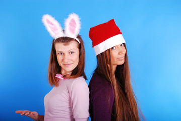 Portrait of beautiful sexy girls wearing santa claus clothes.