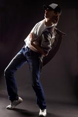 cool man dancer against black background