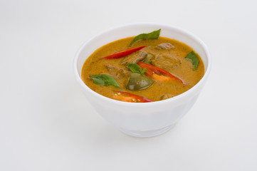red curry in a white bowl