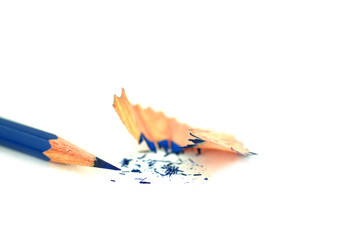 Single blue pencil with pencil sharpening shavings