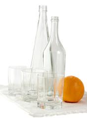 still life: empty bottles glasses and orange
