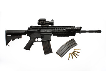 modern assault rifle with a scope and extra magazine and bullets