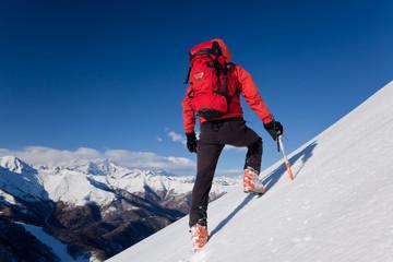 Climbing on a snowed slope