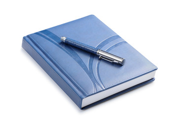 Pen and a closed notebook