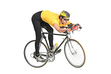 Young man wearing a yellow shirt riding a bicycle